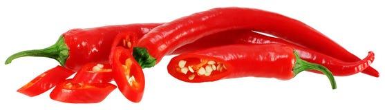 Chiles rojos en blanco. Imagen de archivo libre de regalías