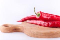 Chiles rojos en tajadera Imagen de archivo libre de regalías