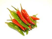 Chiles verdes y rojos Foto de archivo libre de regalías