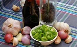 Chiles y especias verdes cortados Foto de archivo