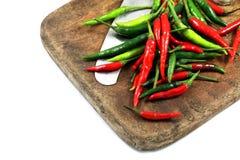 Chili, ножи и старые разделочные доски Стоковые Фото
