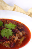 Chili. Delicious fresh bowl of chili complete with tortilla chips royalty free stock photos