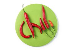 Chili. On green round background Stock Photos