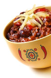 Chili. Bowl of chili with peppers and beans, topped with grated cheese Royalty Free Stock Photos
