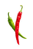 Chili. Ripe, red and green chilis isolated on a white background royalty free stock photo