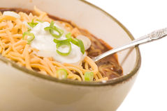 Chili. A fresh bowl of hot chili with melted cheddar cheese and onions Stock Images