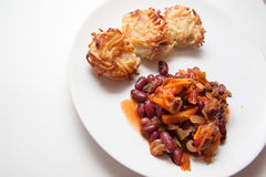 Chili beans and potato pancakes. Potato pancakes:traditional german beer appetiser Stock Photo