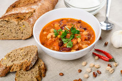 Chili Beans Stew, Bread, Red Chili Pepper And Garlic. Ready To Be Served Royalty Free Stock Photo