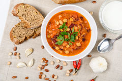 Chili Beans Stew, Bread, Red Chili Pepper And Garlic. Ready To Be Served Stock Photography