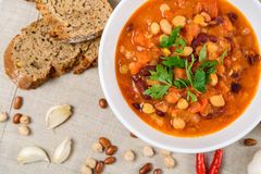 Chili Beans Stew, Bread, Red Chili Pepper And Garlic. Ready To Be Served Royalty Free Stock Photos