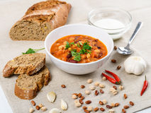 Chili Beans Stew, Bread, Red Chili Pepper And Garlic Royalty Free Stock Photography