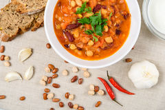 Chili Beans Stew, Bread, Red Chili Pepper And Garlic. Ready To Be Served Stock Image