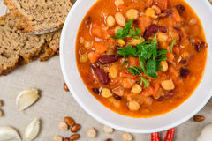 Chili Beans Stew, Bread, Red Chili Pepper And Garlic. Ready To Be Served Royalty Free Stock Images