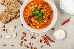 Chili Beans Stew, Bread, Red Chili Pepper And Garlic. Ready To Be Served Royalty Free Stock Photography