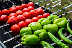 Chili, bell peppers and tomatoes on skewers Stock Photos