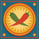 Chili on blue background. Red and green chilies on tribal background Royalty Free Stock Photo