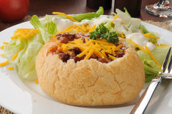 Chili in a bread bowl with salad Stock Photos