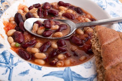 Chili with bread and a spoon stock photography