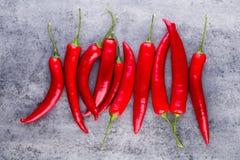 Chili Cayenne pieprz na popielatym tle fotografia stock