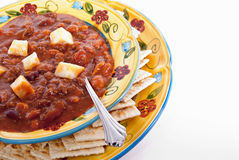 Chili. With cheese and crackers served in colorful double plates Royalty Free Stock Photos