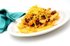 Chili Cheese Fries. Melting cheddar cheese over the top of french fries covered in spicy chili with meat and beans Royalty Free Stock Image