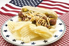 Chili and Cheese Hotdog with American Flag Royalty Free Stock Photo