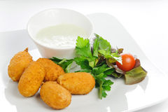 Chili cheese nuggets with tomatoes and greens Royalty Free Stock Photo