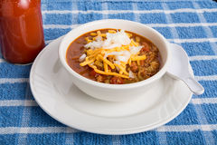 Chili with Cheese Onions and Hot sauce Stock Images