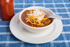 Chili with Cheese and Onions Spoon in Bowl Stock Photography