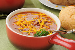 Chili with cheese in a serving crock Stock Image