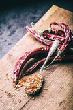 Chili. Chili peppers. Several dried chilli peppers and crushed peppers on an old spoon spilled around. Mexican ingredients Stock Images
