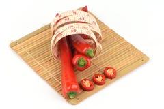 Chili, Chili pieprz, Czerwoni Chillies na białym tle Zdjęcia Stock