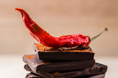 Chili on the chocolate stack Stock Photography