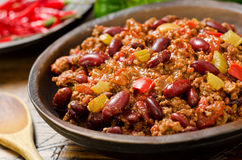 Chili Con Carne. A hot spicy bowl of chili con carne with peppers Royalty Free Stock Photos