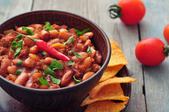 Chili Con Carne. In bowl with tortilla chips on wooden background Stock Photos