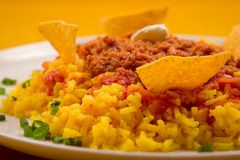 Chili con carne. With yellow rice and nachos Stock Image