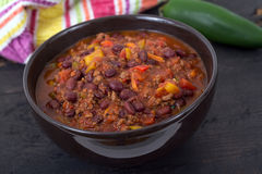 Chili con carne beef chili on black table Royalty Free Stock Images