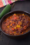 Chili con carne beef chili on black table Stock Photo