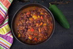 Chili con carne beef chili on black table Stock Photos