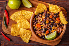 Chili con carne in bowl with tortilla chips. Royalty Free Stock Photo