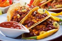 Chili con carne burrito in taco shell Stock Image