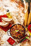 Chili con carne in a clay bowl on a concrete or stone rustic background- traditional dish of mexican cuisine.Top view stock photo