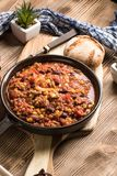Chili con carne in a clay pan. Royalty Free Stock Images