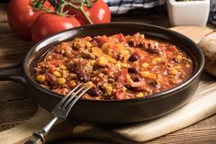 Chili con carne in a clay pan. Stock Photography