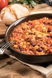 Chili con carne in a clay pan. Stock Photo