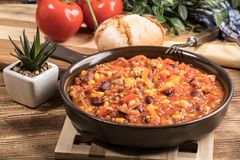 Chili con carne in a clay pan. Royalty Free Stock Photo