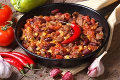 Chili con carne close-up in a frying pan with the ingredients. Royalty Free Stock Photos
