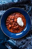 Chili con carne with creme fraiche Stock Photos