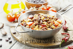 Chili con carne. In the frying pan on a wooden table Stock Image