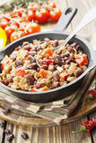 Chili con carne. In the frying pan on a wooden table stock images